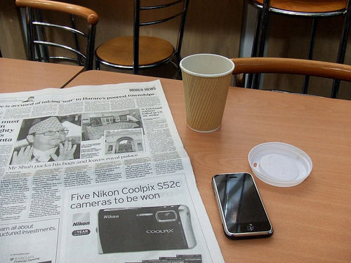 Newspaper, coffee and iPhone