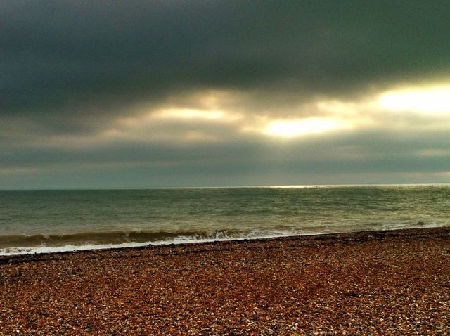 Dramatic sunlight through the clouds on Shoreham Beach